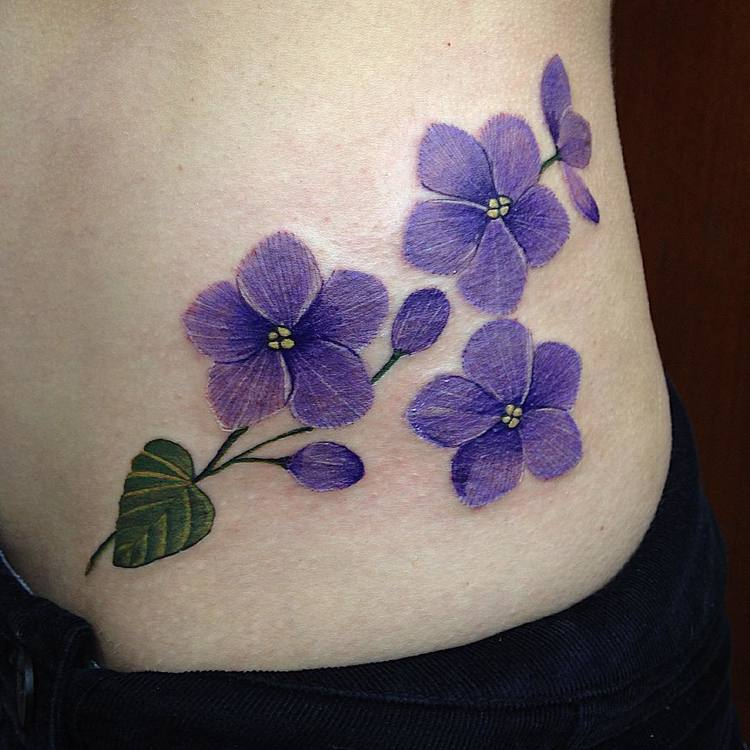 18 beautiful violet tattoo designs and ideas tattooadore rh tattooadore com violet flower tattoo ideas violet flower tattoo meaning