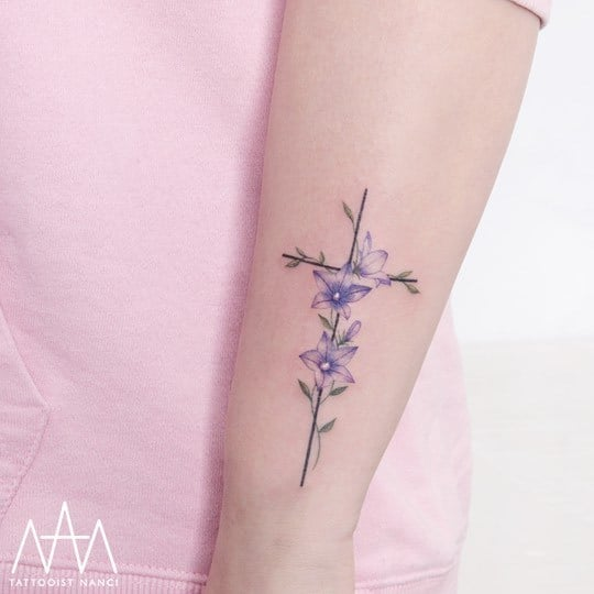 Bellflower and Cross Tattoo on Forearm by Tattooist Nanci