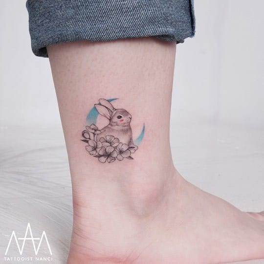 Rabbit, Flowers and Blue Crescent Moon on Ankle by Tattooist Nanci