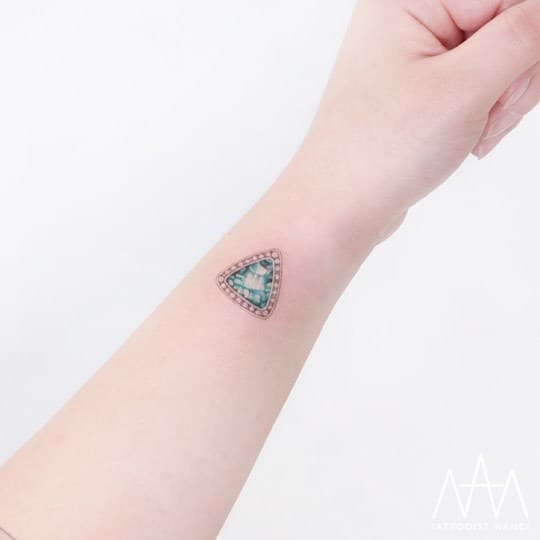 Emerald Tattoo on Wrist by Tattooist Nanci