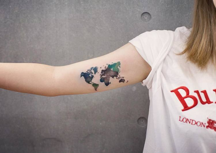 60 stunning watercolor tattoos by chen jie tattooadore 7 world map tattoo on bicep gumiabroncs Image collections