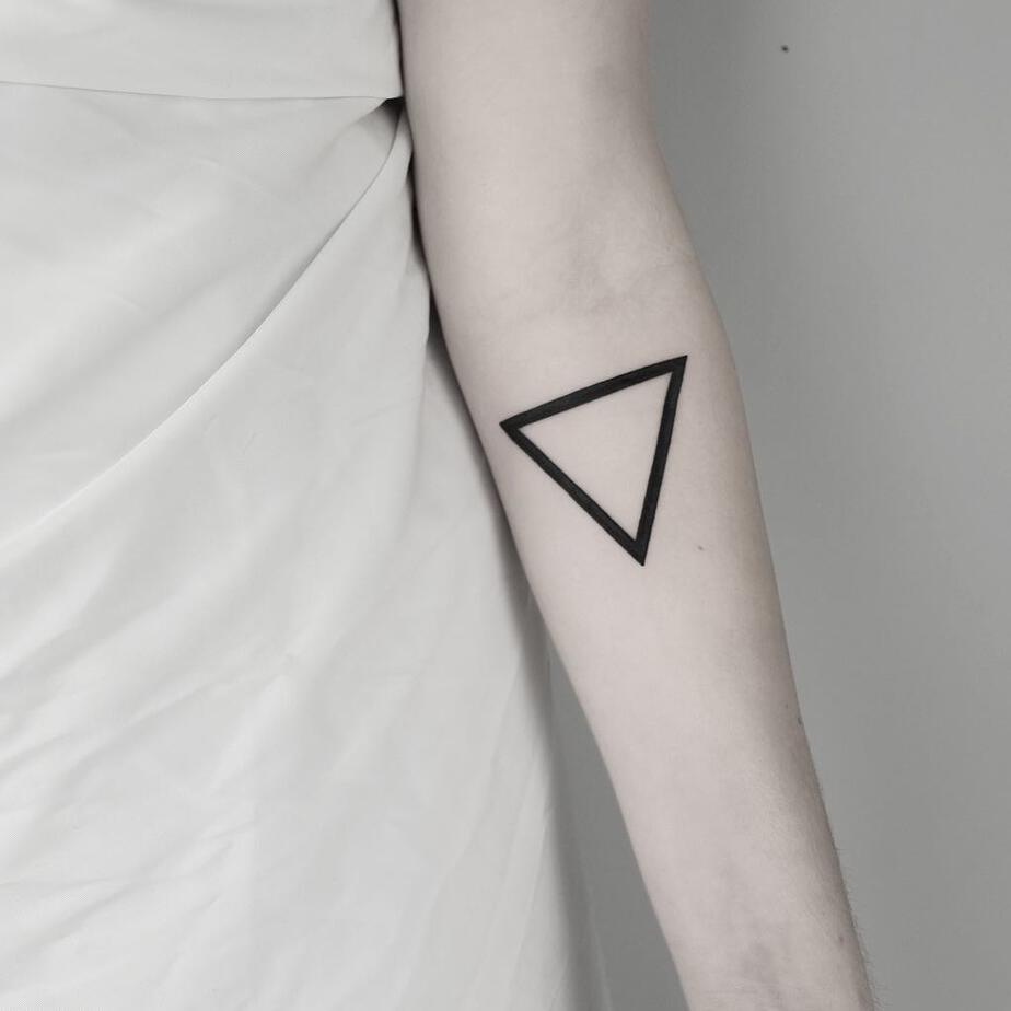Minimal Triangle Tattoo by Malvina Maria Wisniewska