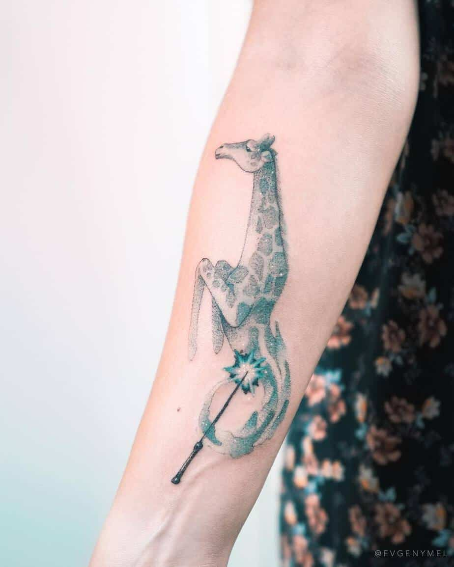 Giraffe and Magic Wand Tattoo by Evgeny Mel