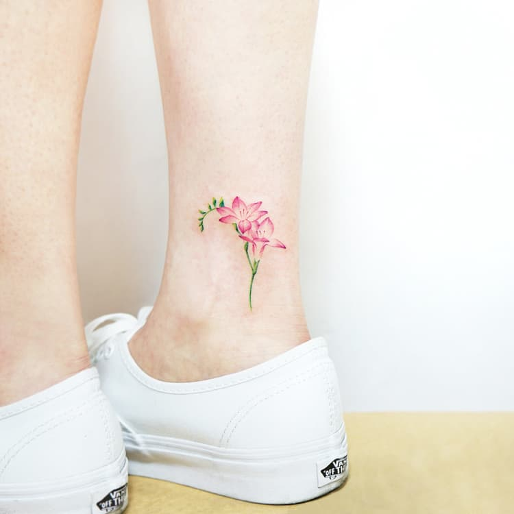 22 Beautiful and Delicate Freesia Tattoo Designs