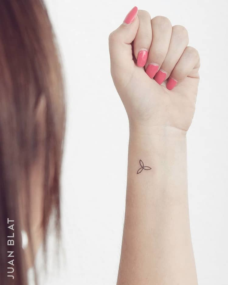 Windmill tattoo on wrist