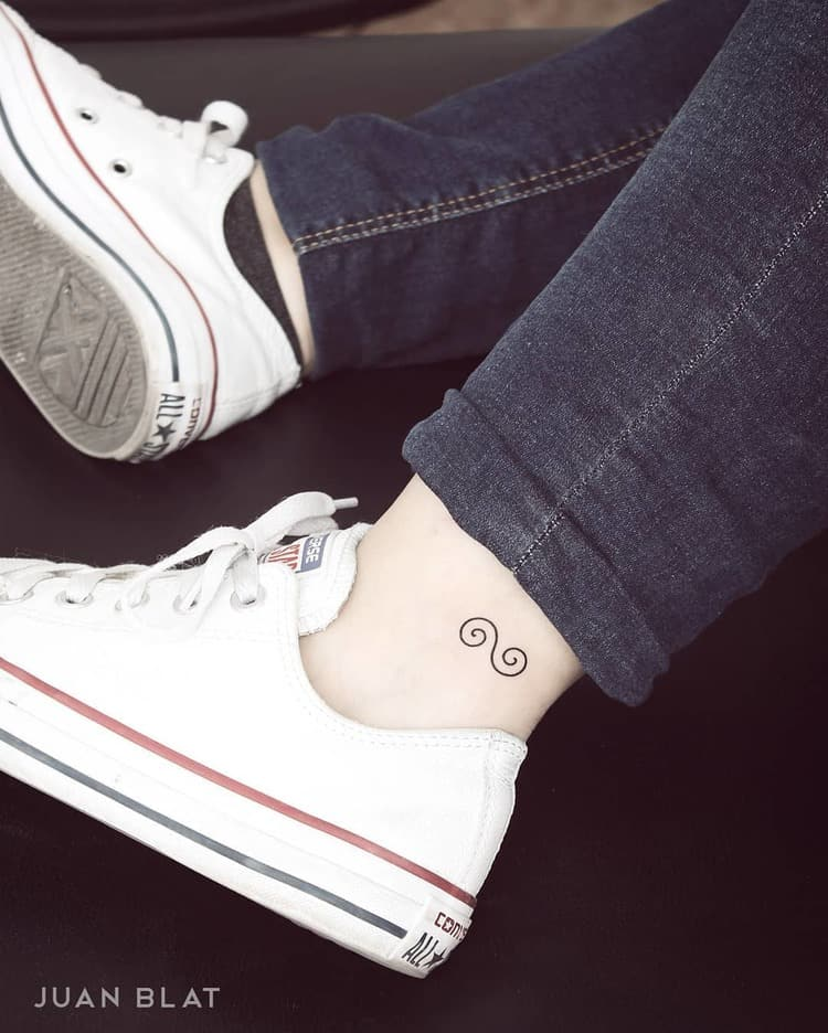 Double swirl tattoo on ankle
