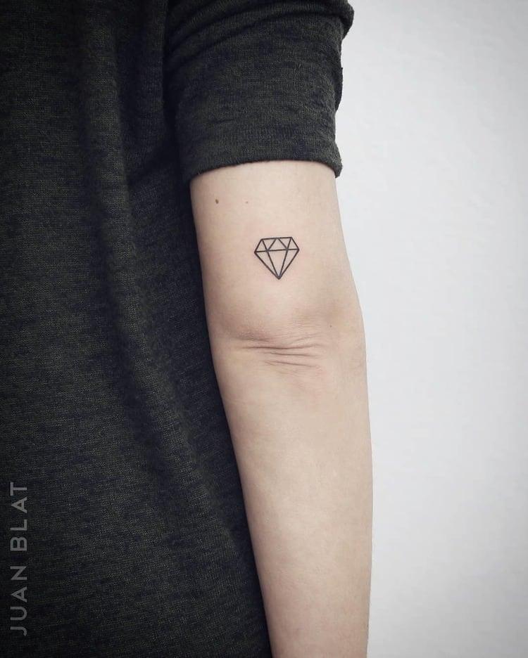 Diamond tattoo on tricep
