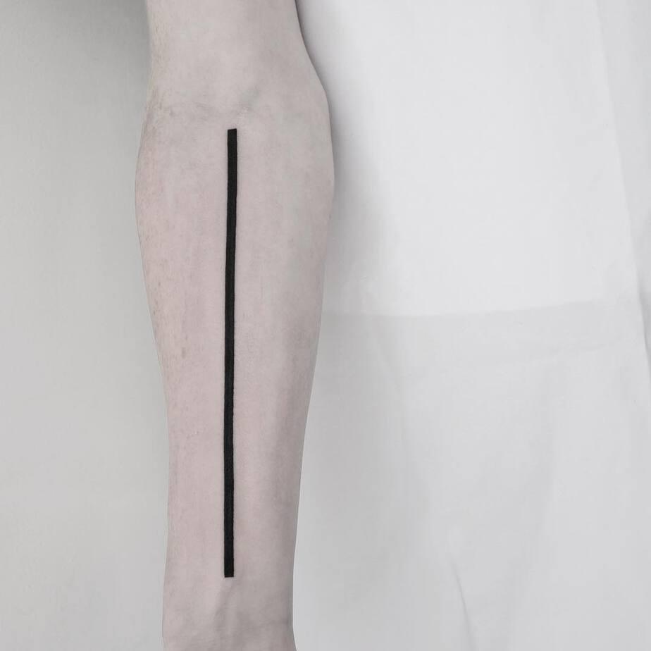 Bold Straight Line Tattoo by Malvina Maria Wisniewska